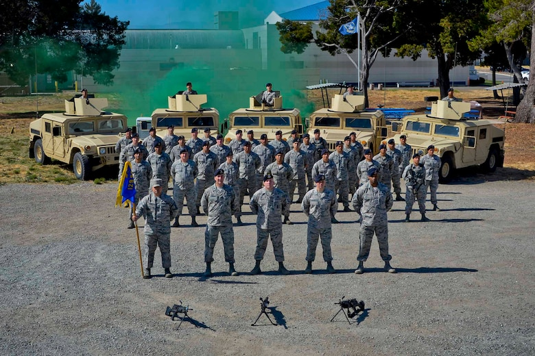 U.S. Air Force Airmen from the 129th Security Forces Squadron pose for a squadron photo at Moffett Air National Guard Base, Calif., July 18, 2017. (U.S. Air National Guard photo by Master Sgt. Ray Aquino/released)