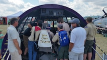Senior Master Sgt. William rudgers and Master Sgt. James Courneya help boy Scouts earn their aviation merit badges at the Wings of the North Airshow at Flying Cloud airport July 15-16. The scouts learned to identify and interpret cockpit instruments from the C-130 flight deck on display at the airshow. (Air Force Photo/Master Sgt. James Courneya)