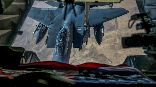 An F-15E Strike Eagle receives fuel from a KC-10 Extender over an undisclosed location in Southwest Asia, July 19, 2017. The F-15E is a dual-role fighter designed to perform air-to-air and air-to-ground missions. The KC-10 is assigned to the 908th Expeditionary Air Refueling Squadron. Air Force photo by Senior Airman Preston Webb