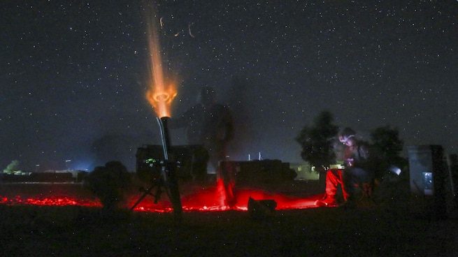 Marines fire a nonexplosive illumination round from an 81 mm mortar to deter enemy activity at Camp Shorserack, Afghanistan, July 15, 2017. The Marines are assigned to Task Force Southwest, which assisted Afghan defense and security forces to clear insurgents from the Nawa district center. Marine Corps photo by Sgt. Lucas Hopkins