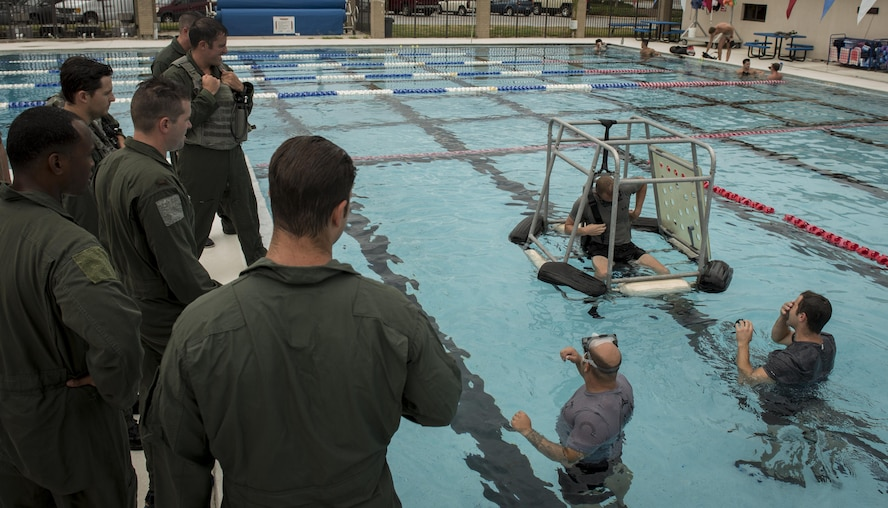 Survival, evasion, resistance and escape specialists with the 1st Special Operations Support Squadron conduct rotary wing water survival training with 8th Special Operations Squadron aircrew at Hurlburt Field, Fla., July 18, 2017. The 1st SOSS SERE specialists conduct rotary wing water survival training quarterly to ensure aircrew are proficient on emergency procedure skill sets. (U.S. Air Force photo by Airman 1st Class Joseph Pick)
