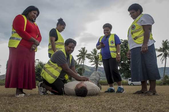 U.S. Air Force Senior Airman Chris Rodgers, an aerospace medical service journeyman with the 35th Medical Operations Squadron at Misawa Air Base, Japan, teaches Fijian health care volunteers the basics of CPR during a hands-on training as part of Pacific Angel 17-3 at Tagitagi Sangam School and Kindergarten in Tavua, Fiji, July 15, 2017. Rodgers and seven other Misawa Airmen joined more than 50 U.S. service members in support of this exercise. The exercise strengthens interoperability and partnership between the United States, Fiji and other nations and organizations in the Indo-Asia-Pacific region. (U.S. Air Force photo by Tech. Sgt. Benjamin W. Stratton)