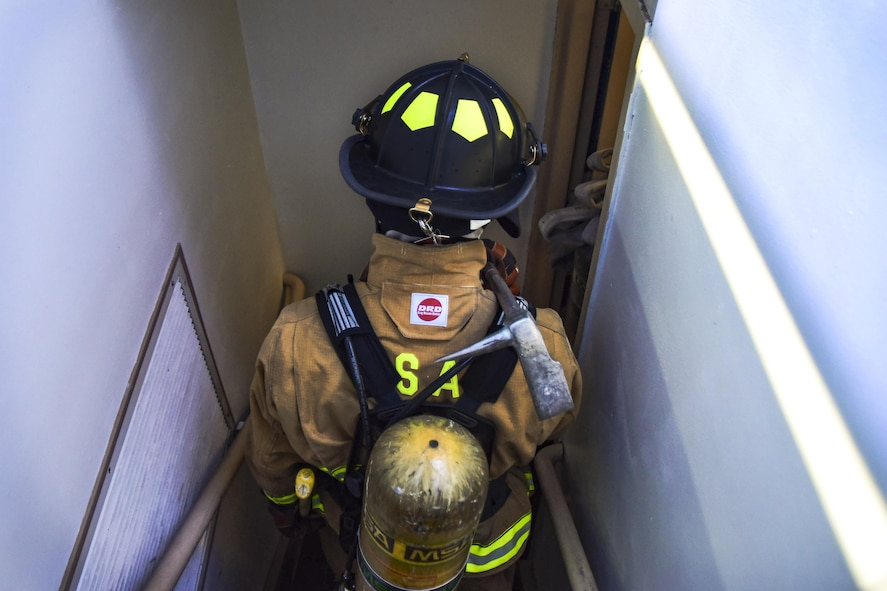 Airman 1st Class Brian Velten, 99th Civil Engineer Squadron firefighter, descends the air traffic control stairwell during Red Flag 17-3 at Nellis Air Force Base, Nev., July 18, 2017. The team raced to the top of the tower to practice evacuation procedures during an electrical fire or medical emergency. (U.S. Air Force photo by Airman 1st Class Andrew D. Sarver/Released)