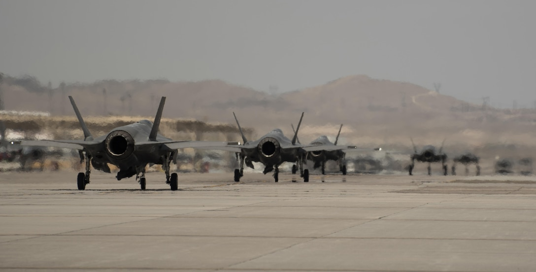 U.S. Air Force F-35A and Marine Corps F-35B Lightning IIs taxi before taking off July 18, 2017, at Nellis Air Force Base, Nev. The 33rd Fighter Wing and Marine Attack Squadron 221 from Yuma, Ariz., participated in the first combat exercise with Air Force F-35As and Marine Corps F-35Bs operating simultaneously during Red Flag 17-3. The large scale exercise, which was developed to provide pilots with critical experience in combat situations, enabled F-35 pilots to plan and train using the same tactics, techniques and procedures. (U.S. Air Force photo by Staff Sgt. Peter Thompson)