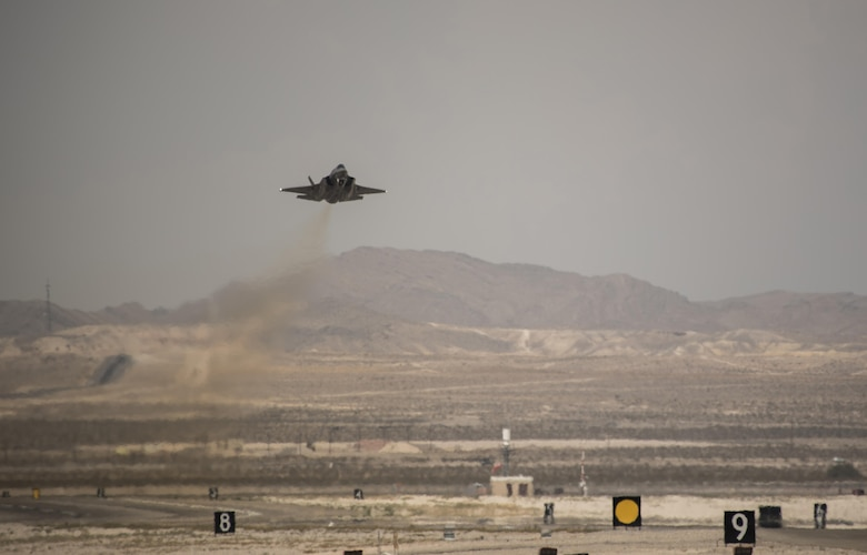 An F-35A Lightning II takes off July 18, 2017, at Nellis Air Force Base, Nev. The 33rd Fighter Wing and Marine Attack Squadron 221 from Yuma, Ariz., participated in the first combat exercise with Air Force F-35As and Marine Corps F-35Bs operating simultaneously during Red Flag 17-3. The large scale exercise, which was developed to provide pilots with critical experience in combat situations, enabled F-35 pilots to plan and train using the same tactics, techniques and procedures. (U.S. Air Force photo by Staff Sgt. Peter Thompson)