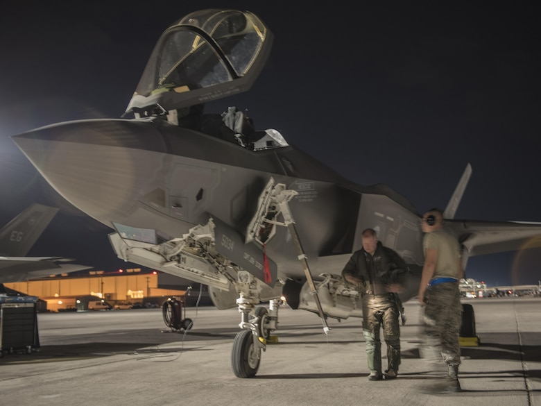 U.S. Air Force Reserve Lt. Col. Brett Robison, F-35 Lightning II Academic Training Center lead pilot, inspects an F-35A Lightning II July 18, 2017, at Nellis Air Force Base, Nev. The 33rd Fighter Wing and Marine Attack Squadron 221 from Yuma, Ariz., participated in the first combat exercise with Air Force F-35As and Marine Corps F-35Bs operating simultaneously during Red Flag 17-3. The large scale exercise, which was developed to provide pilots with critical experience in combat situations, enabled F-35 pilots to plan and train using the same tactics, techniques and procedures. (U.S. Air Force photo by Staff Sgt. Peter Thompson)