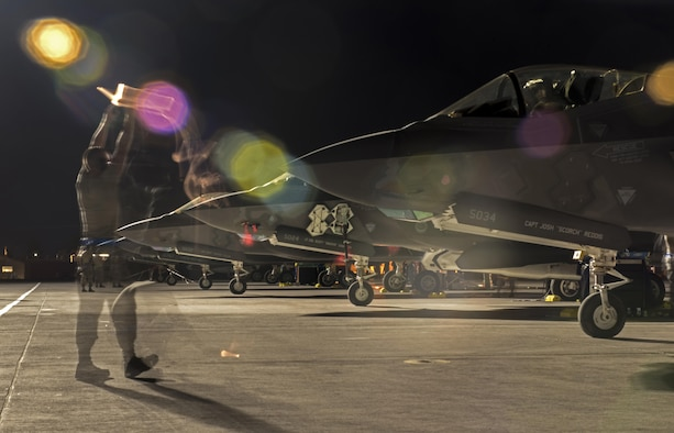 U.S. Air Force Airman 1st Class Travis Jackson, 33rd Aircraft Maintenance Squadron assistant dedicated crew chief, marshals an F-35A Lightning II July 18, 2017, at Nellis Air Force Base, Nev. The 33rd Fighter Wing and Marine Attack Squadron 221 from Yuma, Ariz., participated in the first combat exercise with Air Force F-35As and Marine Corps F-35Bs operating simultaneously during Red Flag 17-3. The large scale exercise, which was developed to provide pilots with critical experience in combat situations, enabled F-35 pilots to plan and train using the same tactics, techniques and procedures. (U.S. Air Force photo by Staff Sgt. Peter Thompson)