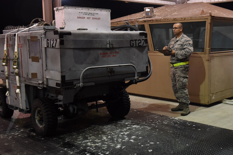 Staff Sgt. Matthew Rico, 4th Logistics Readiness Squadron joint inspector, inspects a generator cart during exercise Thunderdome 17-02, July 20, 2017, at Seymour Johnson Air Force Base, North Carolina. During the exercise, members of the 4th Fighter Wing conducted simulated cargo transport. (U.S. Air Force photo by Airman 1st Class Victoria Boyton)