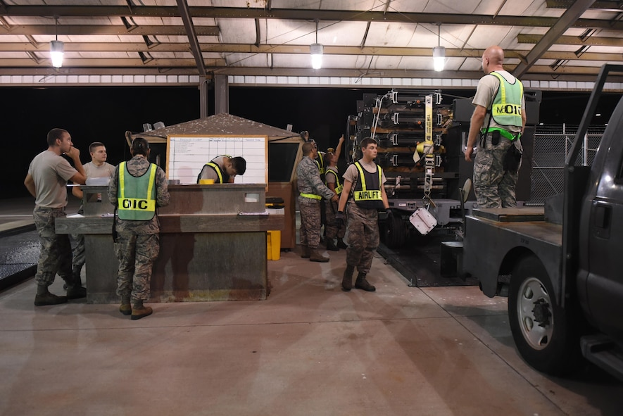 Members of the 4th Fighter Wing prepare cargo equipment for a simulated transport during exercise Thunderdome 17-02, July 20, 2017, at Seymour Johnson Air Force Base, North Carolina. By working together during the exercise, members of the 4th Fighter Wing continue to enhance cargo transportation capabilities. (U.S. Air Force photo by Airman 1st Class Victoria Boyton)
