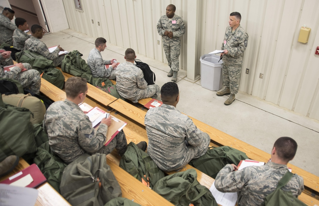 Senior Master Sgt. Virgil McCullough, 4th Force Support Squadron manpower and personnel superintendent, briefs deployers at the PDF processing center July 20, 2017, at Seymour Johnson Air Force Base, North Carolina. The pre-deployment processing was to ensure the deployers had all necessary documents and gear to prior to departing. (U.S. Air Force photo by Tech. Sgt. David W. Carbajal)