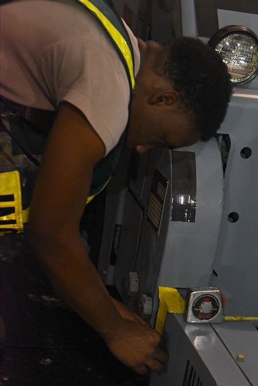 Airman Joshua Shepherd, 4th Logistics Readiness Squadron Travel Management Office receiving technician, places duct tape to mark the balance point on a piece of equipment during Exercise Thunderdome 17-02, July 20, 2017, at Seymour Johnson Air Force Base, North Carolina. Exercises such as this are performed to ensure mission readiness. (U.S. Air Force photo by Senior Airman Ashley Maldonado)