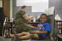Daniel Wilson, a patient attending Innovative Readiness Training Louisiana Care 2017, smiles after getting his teeth inspected by a Navy Corpsman at Amite High School in Amite, La., July 15, 2017. Several of the patients attending the IRT came for dental services such as fillings, simple dental extractions, screenings for oral cancer and examinations for sports medicine injuries. (U.S. Marine Corps photo by Lance Cpl. Niles Lee/Released)