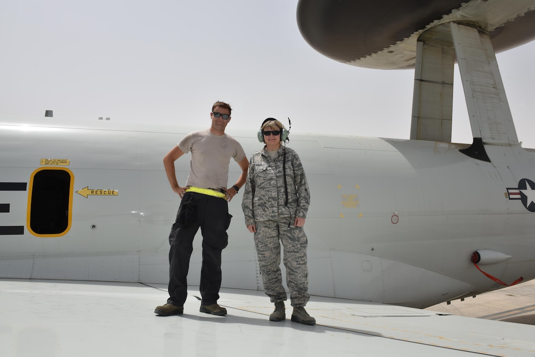 Senior Airman Colt, left, and his mother Maj. Donna, right, stand on the wing of an E-3 Sentry at Al Dhafra Air Base, United Arab Emirates, July 20, 2017. Donna, currently deployed to Al Udeid Air Base, Qatar, coordinated with U.S. Air Forces Central Command and 380th Air Expeditionary Wing leadership to surprise her son. (U.S. Air Force photo by Staff Sgt. Marjorie A. Bowlden)