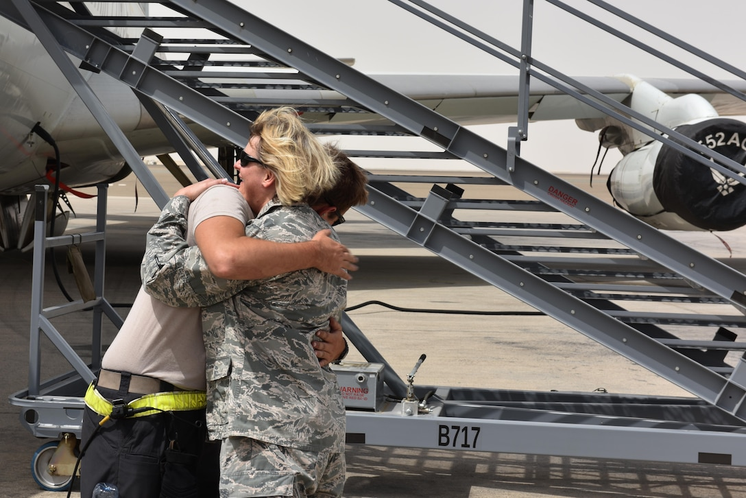 Maj. Donna, U.S. Air Forces Central Command sexual assault response coordinator, and her son Senior Airman Colt embrace at Al Dhafra Air Base, United Arab Emirates, July 20, 2017. Donna and Colt reunited while deployed after spending approximately two years apart. (U.S. Air Force photo by Staff Sgt. Marjorie A. Bowlden)