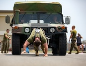 U.S. Marines with Marine Aviation Logistics Squadron 12 pull a Humvee at Marine Corps Air Station Iwakuni, Japan, July 21, 2017. The USO hosted a field meet and cookout for MALS-12, which included several competitions such as grappling, pull-ups and a Humvee pull.