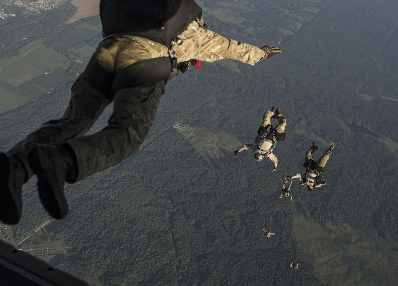 Special Tactics Airmen with the 123rd Special Tactics Squadron, Louisville, Ky., execute a high altitude, low open jump out of a 15th Special Operations Squadron MC-130H Combat Talon II, during a total force exercise mission over Terra Haute, Ind., July 8, 2017. Air Commandos with the 1st Special Operations Wing conduct exercises with joint services to strengthen the development of joint leaders and teams to better understand the synergy of air, space and cyber power, and how to synthesize the capabilities the air component brings with the other elements of joint and national power. (U.S. Air Force photo/Tech. Sgt. Jeffrey Curtin)