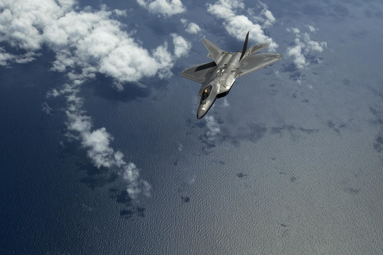 A F-22 Raptor assigned to Joint Base Langley-Eustis, Va., banks away after being refueled by a KC-10 Extender crewed by members of the 78th Air Refueling Squadron, 514th Air Mobility Wing, flies over the Atlantic Ocean July 15, 2017. The F-22 is assigned to Joint Base Langley-Eustis, Va., and is the Air Force's 5th generation fighter aircraft. The KC-10 is an Air Mobility Command advanced tanker and cargo aircraft designed to provide increased global mobility for U.S. Armed Forces and is assigned to the 305th Air Mobility Wing and is maintained and flown by the 514th Air Mobility Wing, Air Force Reserve Command and the 305th. Both units are located at Joint Base McGuire-Dix-Lakehurst, N.J. (U.S. Air Force photo by Master Sgt. Mark C. Olsen/Released)