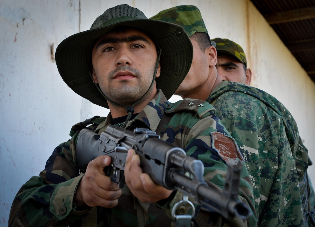 A Tajik service member stands in formation before a close quarters battle practice during a field training exercise part of multinational exercise Regional Cooperation 2017, July 17, 2017, in Fakhrabad, Tajikistan. Regional Cooperation has been conducted annually since 2001; the last exercise was held Sept. 16-28, 2016, in Cape Cod, Massachusetts. (U.S. Air Force photo by Staff Sgt. Michael Battles)