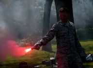 Master Sgt. Braden Duszynski, a munitions specialist with the 128th Air Refueling Wing, holds a signal flare during aircrew survival training at Grant Park in Milwaukee, Wisc., July 15, 2017.  This survival training is designed to instruct Airmen on how to endure threatening survival scenarios. (U.S. Air National Guard photo by Senior Airman Morgan R. Lipinski/Released)
