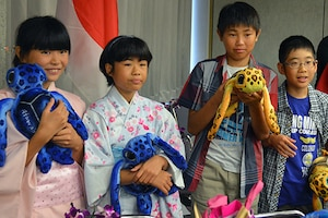 "From left to right, Kumiko Yasui, Mihi Tazawa, Yosuke Yamaguchi, and Kirito Uchikaneku, are four children from The Holy Family Home in Osaka, Japan, at a welcoming reception held by the 27th Infantry Regiment ""Wolfhounds"" at the Honolulu International Airport, Hawaii, on July 29, 2016. The 27th Wolfhounds host orphans from The Holy Family Home for an annual summer visit. Army photo by Staff Sgt. Armando R. Limon"