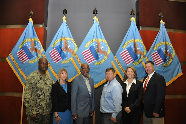 DLA CENTCOM & SOCOM Joint Logistics Operations Center team (from left to right) Navy Cmdr. Andrew Brackenridge, Patricia Kowalski, Kenneth Brown, Edward Miiler, Wendy Yonce and Robert McGuire.