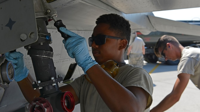 Airman Deric Quiroz, 31st Aircraft Maintenance Squadron crew chief, attaches a fuel hose to an F-16 Fighting Falcon, July 19, 2017, at Aviano Air Base, Italy. Airmen from the 31st Logistics Readiness Squadron joined forces with Air Force reservists assigned to the 512th LRS, Dover Air Force Base, Delaware, to refuel F-16s to keep them mission ready. (U.S. Air Force photo by Senior Airman Cary Smith)