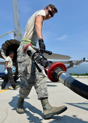 Airman 1st Class Aaron Sewell, 31st Logistics Readiness Squadron Petroleum, Oil and Lubricants distribution operator, prepares to refuel an F-16 Fighting Falcon, July 19, 2017, at Aviano Air Base, Italy. Air Force reservists assigned to the 512th LRS, Dover Air Force Base, Delaware, joined the 31st LRS for two weeks of training. (U.S. Air Force photo by Senior Airman Cary Smith)