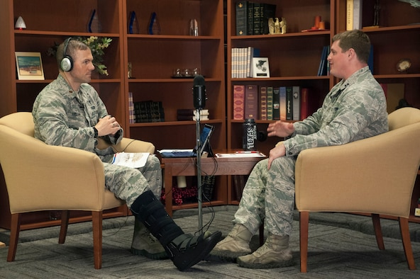 "Chaplain (Maj.) Jim Bridgeham, 363rd Intelligence, Surveillance, and Reconnaissance Wing chaplain, left, and Capt. Jerry Walker, wing psychologist and acting wing surgeon general, record the twelfth episode of their resilience podcast, ""The Pillars,"" at Joint Base Langley-Eustis, Virginia, July 6, 2017. The 363rd ISR Wing is spread across several bases and mission locations, and the podcast has been a great format for those Airmen to be included in resilience training. (United States Air Force photo by Jennifer Spradlin)"