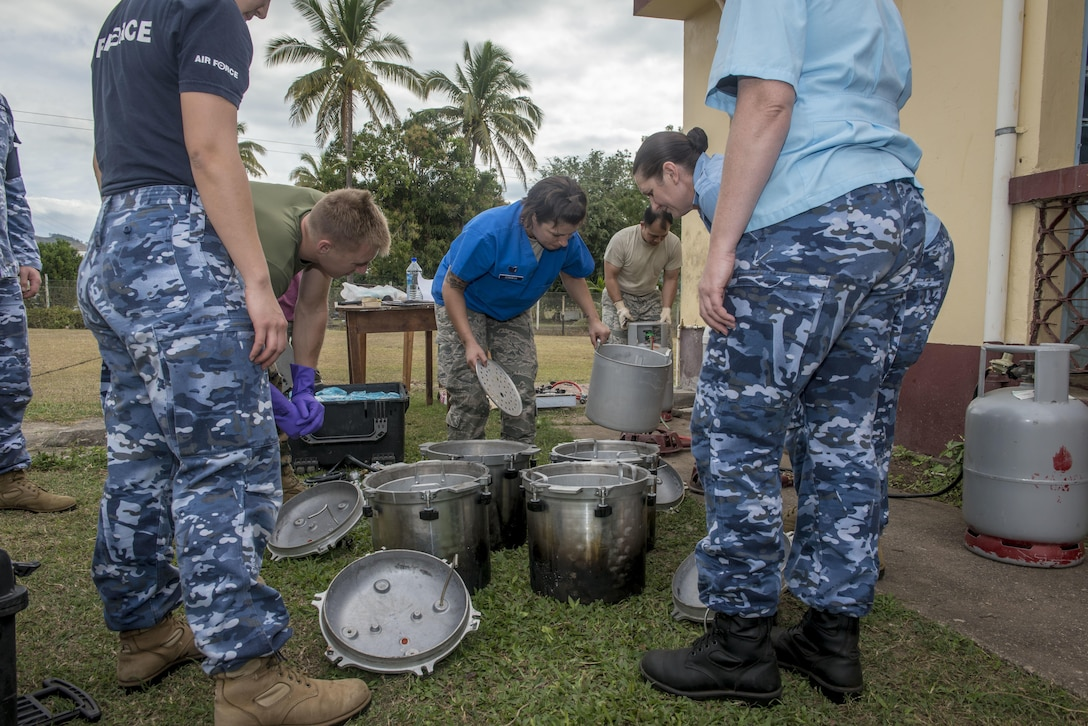 U.S. Air Force Tech. Sgt. Michelle Zenawick, a certified dental technician with the 36th Medical Group at Andersen Air Force Base, Guam, shows U.S. and Australian service members how to properly sterilize dental tools and equipment using pressure cookers during Pacific Angel 17-3 at Tagitagi Sangam School and Kindergarten in Tavua, Fiji, July 15, 2017. With limited facilities and no other way to sterilize their equipment, Zenawick and her team improvised, ensuring the humanitarian medical service could continue without a hitch. (U.S. Air Force photo/Tech. Sgt. Benjamin W. Stratton)