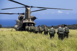 SCHOFIELD BARRACKS – Marines with 4th Force Reconnaissance Company and U.S. Army Special Forces soldiers board a CH-47 Chinook helicopter to conduct a high altitude airborne jump at Schofield Barracks, July 14, 2017. The Marines trained with U.S. Army Special Forces to maintain proficiency in completing static line and high altitude free fall airborne jumps.