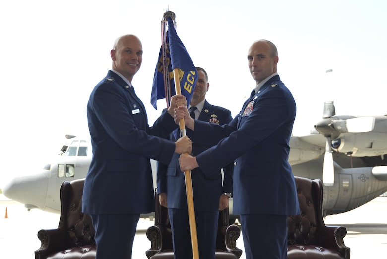 Col. Michael Manion (left), 55th Wing commander, passes the 55th Electronic Combat Group guidon to Col. Phil Acquaro who assumed command of the unit July 10, 2017 at Davis-Monthan Air Force Base, Arizona. (U.S. Air Force photo)