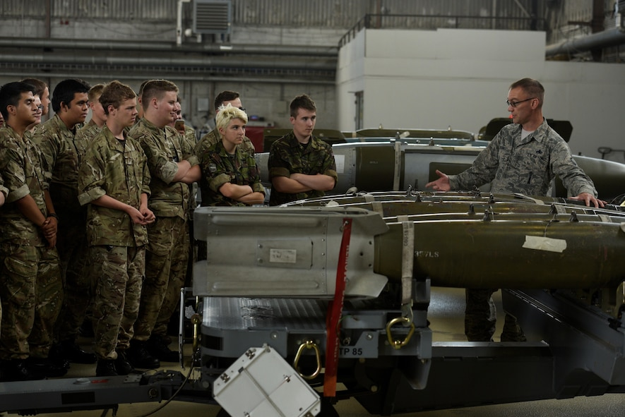 Master Sgt. Jason Tremmel, 52nd Maintenance Group loading standards crew team chief, talks about the munitions that go on the F-16 Fighting Falcon to Royal Air Force Air Cadets at Spangdahlem Air Base, Germany, July 20, 2017. The cadets visited several different squadrons around base to give them a glimpse into U.S. Air Force operations. (U.S. Air Force photo by Staff Sgt. Jonathan Snyder)