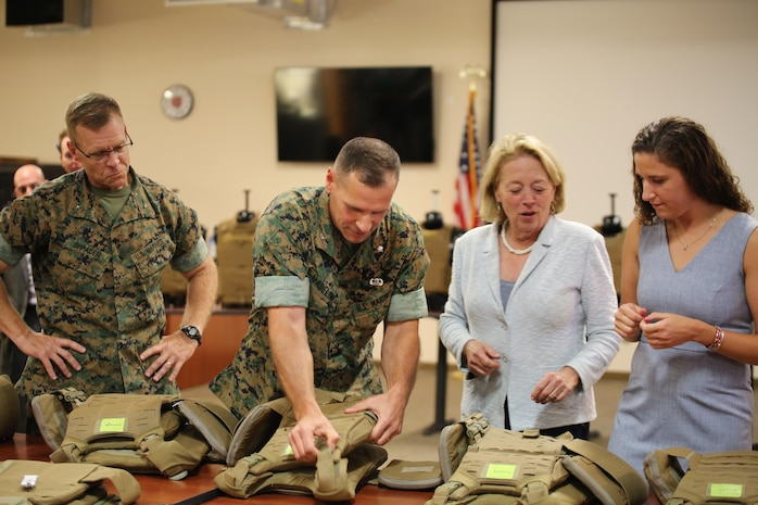 Massachusetts Congresswoman Niki Tsongas joins Marine Corps Systems Command acquisition experts aboard Marine Corps Base Quantico, Virginia, July 11, for a sneak peek at the latest gear for the 21st Century Marine. In a series of ongoing efforts, the Corps and the Army are collaborating to develop, test and deliver ever-better capabilities for Marines and Soldiers. From left: Brig. Gen. Joseph Shrader, MCSC commander; Lt. Col. Chris Madeline, program manager for Infantry Combat Equipment; Rep. Tsongas; and Mackie Jordan, an engineer in PM ICE. (U.S. Marine Corps photo by Emily Greene)