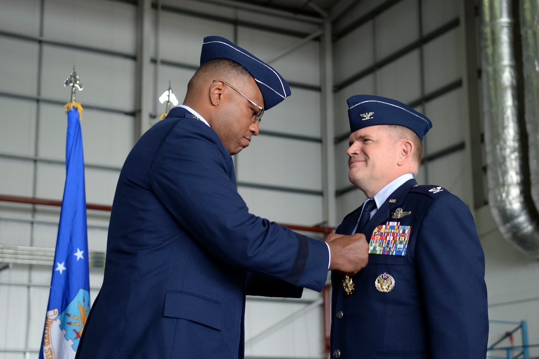 U.S. Air Force Lt. Gen. Richard M. Clark, 3rd Air Force commander, pins the Legion of Merit medal on U.S. Air Force Col. Thomas D. Torkelson, 100th Air Refueling Wing outgoing commander July 21, 2017, on RAF Mildenhall, England. The Legion of Merit award represents exceptionally meritorious conduct in the performance of outstanding service and achievements. (U.S. Air Force photo by Airman 1st Class Luke Milano)