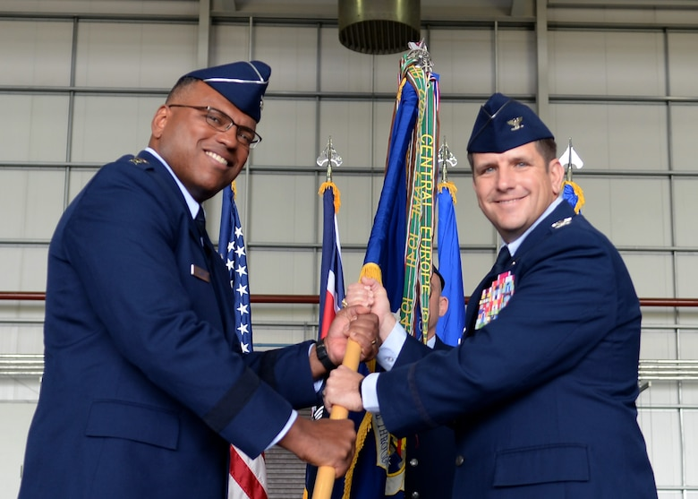 U.S. Air Force Lt. Gen. Richard M. Clark, 3rd Air Force commander, gives command of the 100th Air Refueling Wing to U.S. Air Force Col. Christopher R. Amrhein, 100th ARW commander, during the 100th ARW change of command ceremony July 21, 2017, on RAF Mildenhall, England. The passing of the unit guidon during a change of command ceremony is symbolic representation of passing authority to the incoming commander. (U.S. Air Force photo by Airman 1st Class Luke Milano)