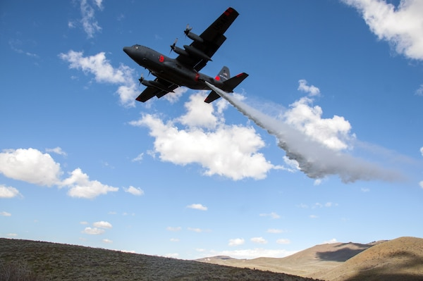 A C-130 with the 152nd Airlift Wing, Nevada Air National Guard, drops water in the mountains east of Boise, Idaho as part of the annual Modular Airborne Fire Fighting System training and certification, April 21, 2017. More than 400 personnel of four C-130 Guard and Reserve units — from California, Colorado, Nevada and Wyoming, making up the Air Expeditionary Group — are in Boise for the week-long wildfire training and certification sponsored by the U.S. Forest Service.