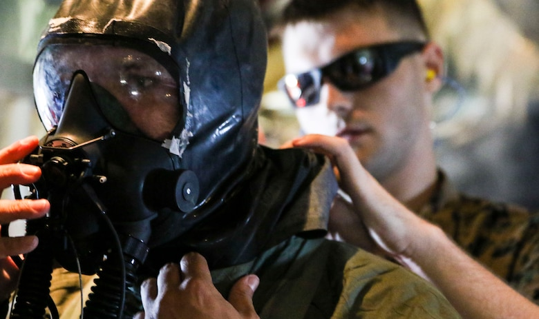 Marines assigned to Marine Aerial Refueler Transport Squadron 252 participate in a Chemical, Biological, Radiological, and Nuclear training exercise at Marine Corps Air Station Cherry Point, July 13, 2017. The training expanded upon the Marines knowledge of how to properly react and contain a CBRN attack aboard a KC-130J Super Hercules. VMGR-252 is assigned to Marine Aircraft Group 14, 2nd Marine Aircraft Wing. (U.S. Marine Corps photo by Cpl. Jason Jimenez/ Released)