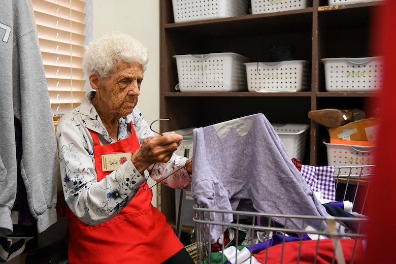 Hill Thrift Shop volunteer Lela Gibson puts a shirt onto a hanger, Hill Air Force Base, Utah, July 20, 2017. Gibson has volunteered at the store since 2009 and will celebrate her 100th birthday Aug. 5. (U.S. Air Force photo/R. Nial Bradshaw)