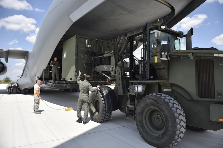 A loadmaster directs the positioning of a forklift to load cargo onto a C-17 Globemaster during Exercise Saber Guardian '17 at Bezmer Air Base, Bulgaria, July 19, 2017.  The largest of the Black Sea region exercises, SG17 highlights participant deterrence capabilities, specifically the ability to mass forces at any given time anywhere in Europe to support the security and stability of the Black Sea region.  (U.S. Air Force Photo by Tech. Sgt. Liliana Moreno/Released)