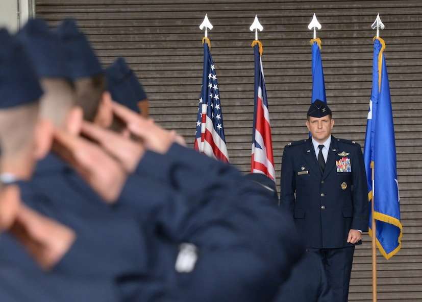 U.S. Air Force Col. Christopher Amrhein receives his first salute as the commander of the 100th Air Refueling Wing July 21, 2017, during the change of command ceremony on RAF Mildenhall, England. Airmen, families, friends and members of the local community came to bid farewell to the outgoing commander, Col. Thomas Torkelson, and welcome Amrhein and his family. (U.S. Air Force photo by Senior Airman Justine Rho)