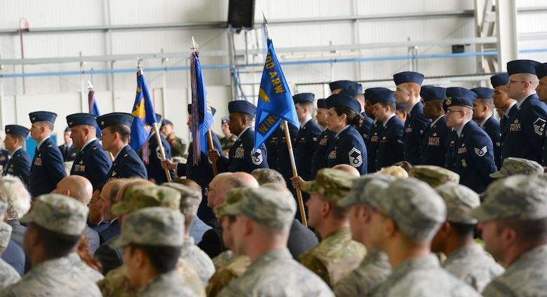 Airmen stand in formation during the 100th Air Refueling Wing change of command ceremony July 21, 2017 on RAF Mildenhall, England. The formation represents the base population when rendering the final salute to the outgoing commander, Col. Thomas Torkelson, and the first salute to the 100th ARW Commander Col. Christopher Amrhein. (U.S. Air Force photo by Senior Airman Justine Rho)