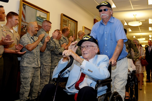 Navy veteran Donald Stratton salutes fellow service members honoring him and other survivors of the battleship USS Arizona during an event at the Pentagon, July 21, 2017. Stratton is one of five known living survivors of the Arizona which was sunk during the Japanese attack on Pearl Harbor, Dec. 7, 1941.