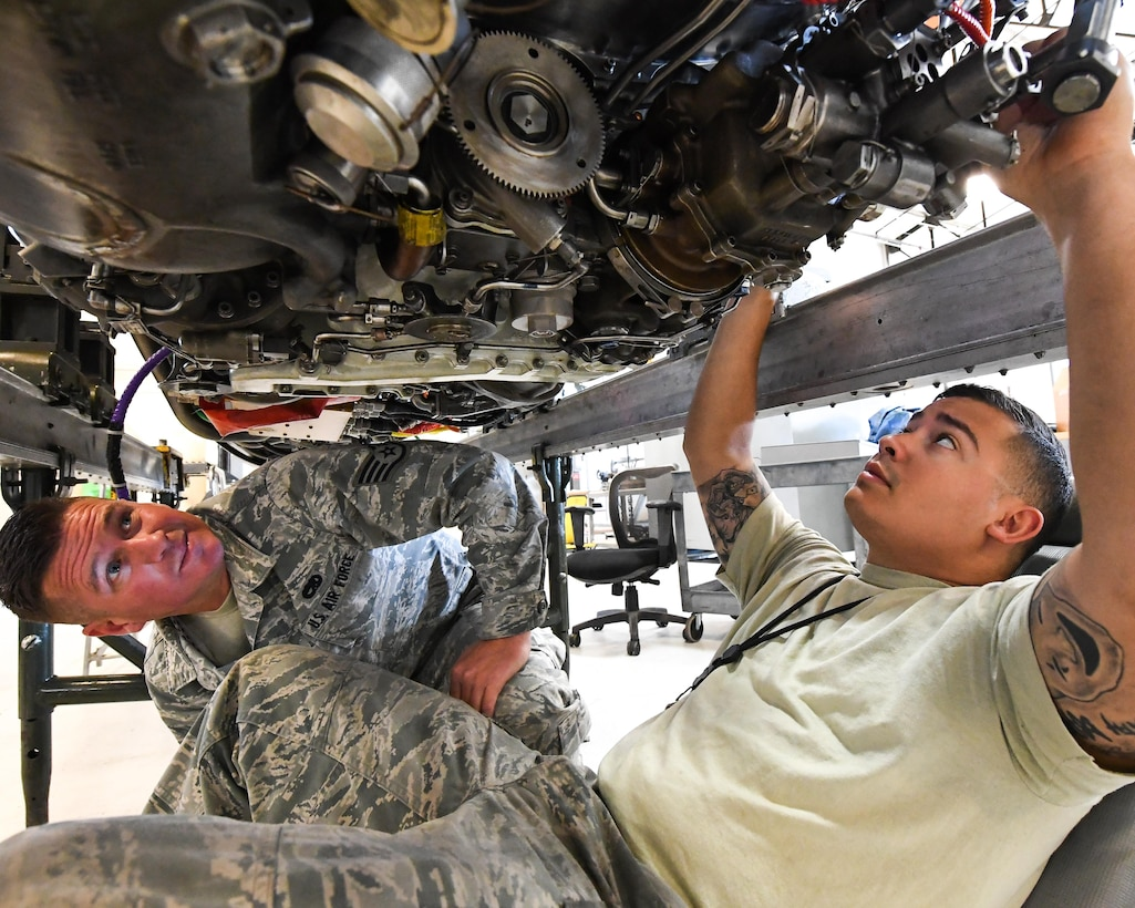Staff Sgt. Cody Bain, left, 419th Maintenance Squadron Propulsion Flight and Senior Airman Elias Oquendo, 388th Maintenance Squadron Propulsion Flight, perform final maintenance and inspections on an F-16 jet engine, Hill Air Force Base, Utah, July 13, 2017. The total force unit overhauls F110-GE-100 engines for Hill, Holloman and Nellis Air Force Bases. (U.S. Air Force photo/R. Nial Bradshaw)