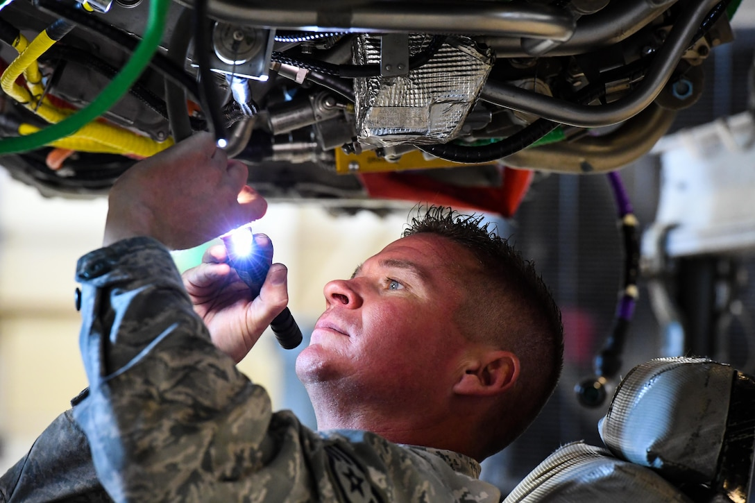 Staff Sgt. Cody Bain, 419th Maintenance Squadron Propulsion Flight, performs final inspections on an F110-GE-100 jet engine, Hill Air Force Base, Utah, July 13, 2017. The unit produces 30-50 overhauled engines per year for Hill, Holloman and Nellis Air Force Bases. (U.S. Air Force photo/R. Nial Bradshaw)