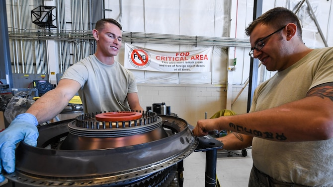 Airman 1st Class Joseph Cockerham, left, 388th Maintenance Squadron Propulsion Flight and Staff Sgt. Christopher Basile, 419th Maintenance Squadron Propulsion Flight, tear down an F-16 compressor unit, Hill Air Force Base, Utah, July 13, 2107. The total force unit produces overhauled F110-GE-100 engines for Hill, Holloman and Nellis Air Force Bases. (U.S. Air Force photo/R. Nial Bradshaw)