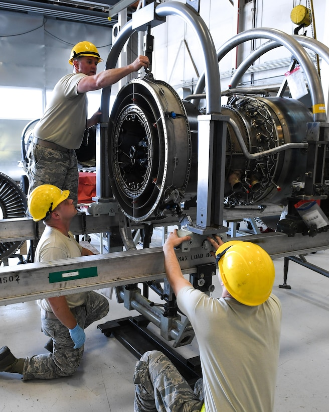 Total Force Airmen assigned to the 388th/419th Maintenance Squadron Propulsion Flight secure an F110-GE-100 jet engine onto a work stand, Hill Air Force Base, Utah, July 13, 2017. (U.S. Air Force photo/R. Nial Bradshaw)