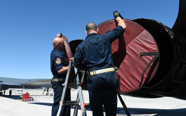 U.S. Air Force Tech. Sgt. Christopher Dial, left, and Staff Sgt. Christopher Graham, 337th Test and Evaluation Squadron B-1 avionics technicians, at Nellis Air Force Base, Nev., June 14, 2017. The 337th TES spent time at Nelllis AFB conducting operational testing on Sustainment Block 17 with students and instructors at the U.S. Air Force Weapons School.