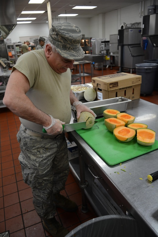 Tech. Sgt. Antony Lucia, 145th Airlift Wing services Airman, prepares cantaloupe for Northern Lightning 2017 participants at Volk Field Air National Guard Base, Camp Douglas, Wis., May 9, 2017. The 40 services Airmen and Soldiers from across the nation prepared meals for approximately 6,500 exercise participants during the two-week exercise. (U.S. Air National Guard photo by Staff Sgt. Andrea F. Rhode)