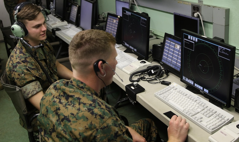 Lance Cpl. Evan Kowalski and Lance Cpl. Michael Hamilton monitor the display screens of the AN/TPS-31A V7 Air Traffic Navigation, Integration, and Coordination System during a week-long training exercise at Marine Corps Air Station Cherry Point, N.C., July 17, 2017. The ATNAVICS is an expeditionary radar system, capable of being transported by aircraft to help Marines monitor an established runway throughout areas of operation around the globe. Kowalski and Hamilton are air traffic controllers assigned to Air Traffic Control Crew 2, Headquarters and Headquarters Squadron, MCAS Cherry Point. (U.S. Marine Corps Photo by Pfc. Skyler Pumphret/ Released)