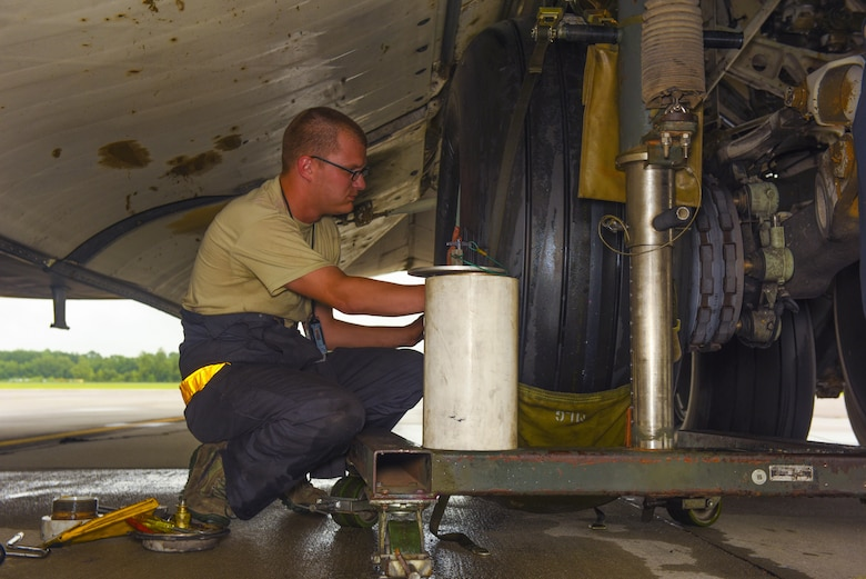 Staff Sgt. Stephen Gasperic, 437th Aircraft Maintenance Squadron crew chief, performs a tire change on a C-17 Globemaster III on the flightline at Joint Base Charleston, S.C. July 17, 2017. The C-17's airlift capabilities are used to deploy U.S. armed forces anywhere in the world within hours. Additionally the C-17's help sustain troops in  conflict, humanitarian, airlift and airdrop efforts.